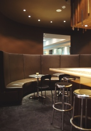 Iffy Cafe 04_curved leather banquette seating area_Stephen Varady Photo ©